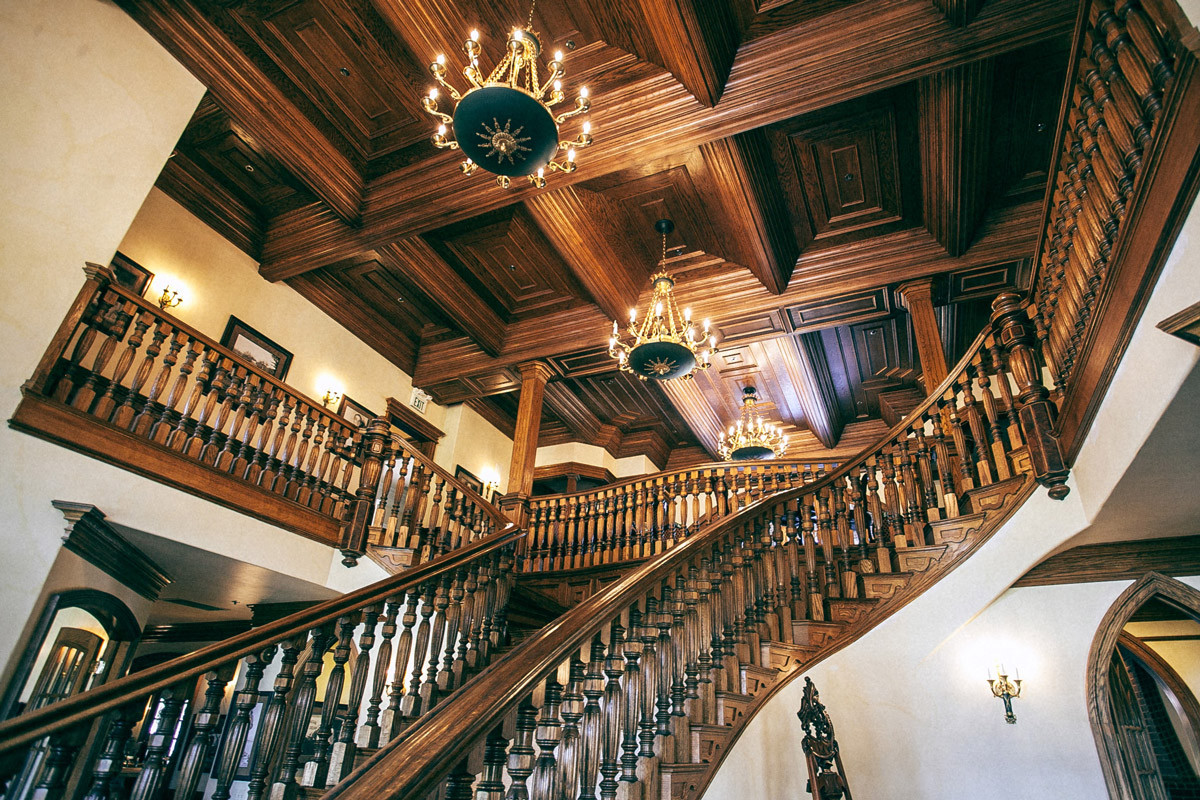 Historic interior design with wooden staircase and ceiling panels